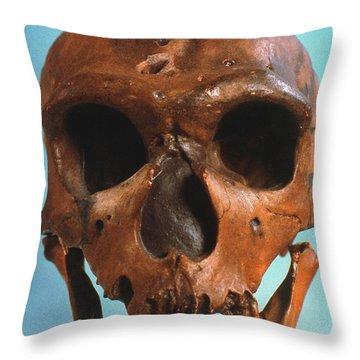 Neanderthal Skull Throw Pillow by Granger