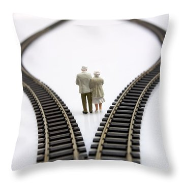 Figurines Between Two Tracks Leading Into Different Directions Symbolic Image For Making Decisions. Throw Pillow by Bernard Jaubert