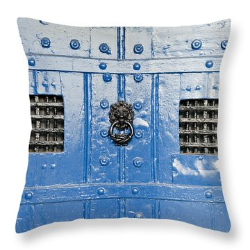 Old Blue Door Throw Pillow by Tom Gowanlock