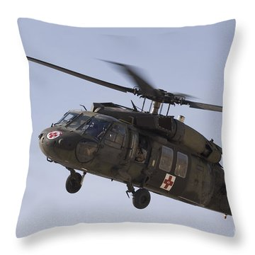 A Uh-60 Blackhawk Medivac Helicopter Throw Pillow by Terry Moore