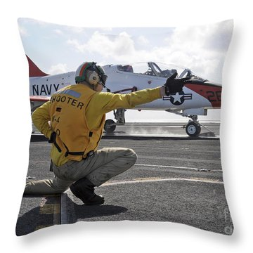 A Shooter Launches A T-45 Goshawk Throw Pillow by Stocktrek Images