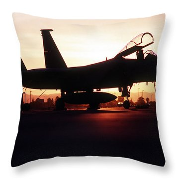 An F-15c Eagle Aircraft Silhouetted Throw Pillow by Stocktrek Images