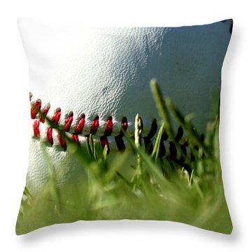 Baseball In Grass Throw Pillow by Chris Brannen