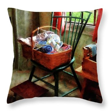 Basket Of Cloth And Yarn On Chair Throw Pillow by Susan Savad