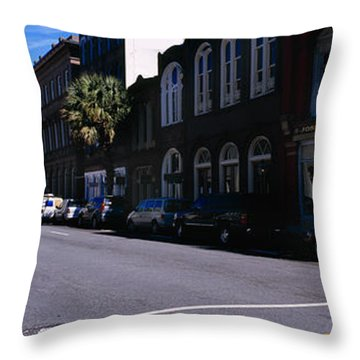 Buildings On Both Sides Of A Road Throw Pillow by Panoramic Images