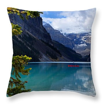 Canoe On Lake Louise Throw Pillow by Larry Ricker