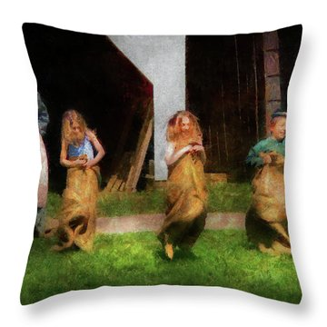 Children - The Sack Race  Throw Pillow by Mike Savad