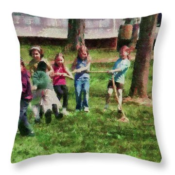 Children - Tug Of War  Throw Pillow by Mike Savad