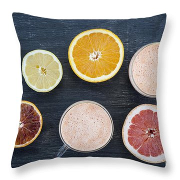 Citrus Smoothies Throw Pillow by Elena Elisseeva