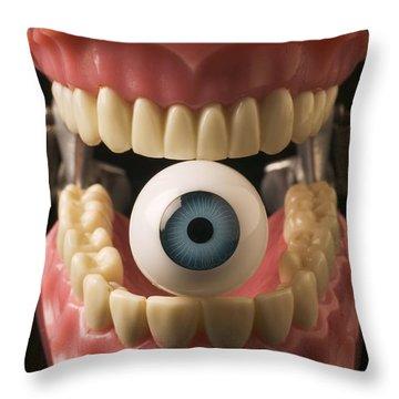 Eye Held By Teeth Throw Pillow by Garry Gay