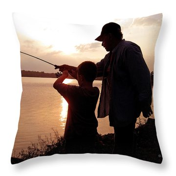 Throw Pillow featuring the photograph Fishing At Sunset Grandfather And Grandson by A Gurmankin