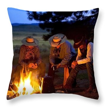 Group Of Cowboys Around A Campfire Throw Pillow by Richard Wear