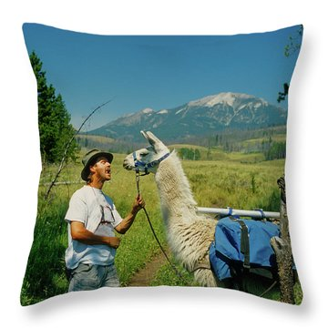Man Teasing A Llama Throw Pillow by Jerry Voss