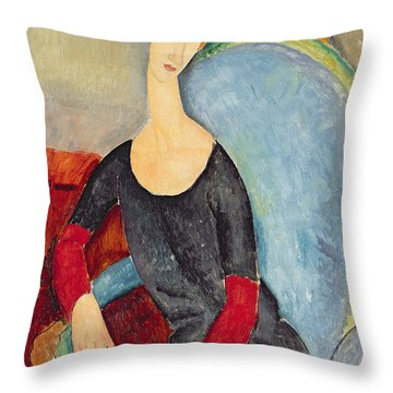 Mme Hebuterne In A Blue Chair Throw Pillow by Amedeo Modigliani
