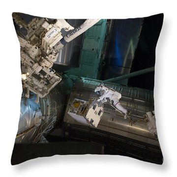 Spacewalk On Iss Throw Pillow by NASA/Science Source