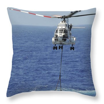 Two Sa-330 Puma Helicopters Deliver Throw Pillow by Stocktrek Images