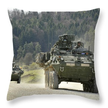Two Stryker Vehicles At The Hohenfels Throw Pillow by Stocktrek Images
