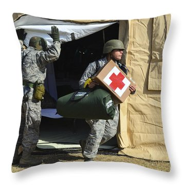 U.s. Air Force Soldier Exits A Medical Throw Pillow by Stocktrek Images