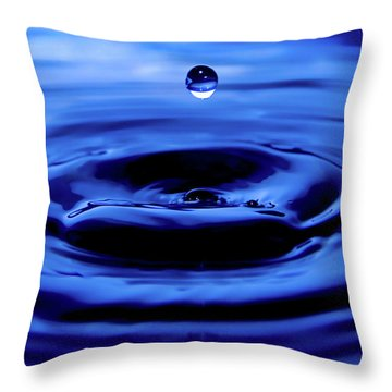 Water Drop Throw Pillow by Eric Ferrar