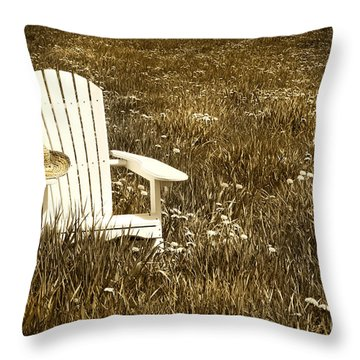 White Chair With Straw Hat In A Field Throw Pillow by Sandra Cunningham