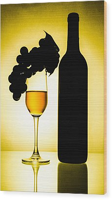 Bottle And Wine Glass Wood Print by Sirapol Siricharattakul