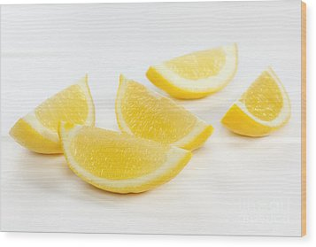 Lemon Wedges On White Background Wood Print by Colin and Linda McKie