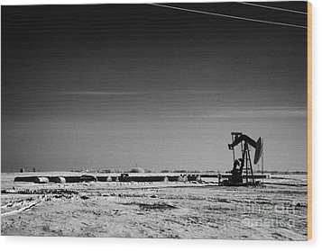 snow covered prairie agricultural farming land with pumpjacks oilfield winter Forget Saskatchewan Ca Wood Print by Joe Fox