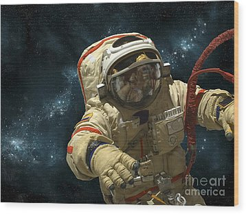 A Cosmonaut Against A Background Wood Print by Marc Ward