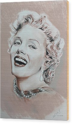 A Lady In Pink Wood Print by Miguel Rodriguez