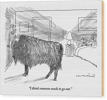 A Large Buffalo Stands Near The Door Wood Print by Michael Crawford