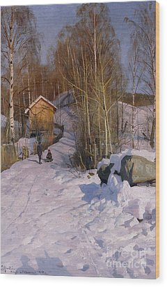 A Winter Landscape With Children Sledging Wood Print by Peder Monsted