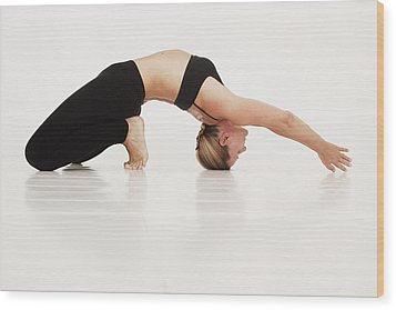 A Woman In A Yoga Pose Tarifa, Cadiz Wood Print by Marcos Welsh