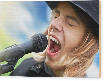 A Young Man Sings To A Microphone Wood Print by Michal Bednarek