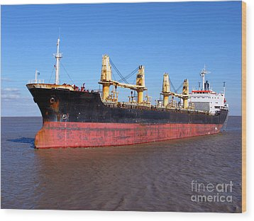 Cargo Ship Wood Print by Olivier Le Queinec