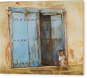 Child Sitting In Old Zanzibar Doorway Wood Print by Sher Nasser