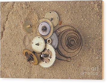 Clockwork Mechanism On The Sand Wood Print by Michal Boubin