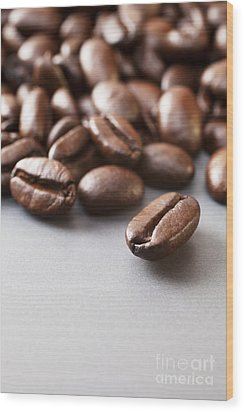 Coffee Beans On Grey Ceramic Surface Wood Print by Colin and Linda McKie