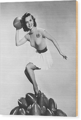 Debbie Reynolds Throws A Pass Wood Print by Underwood Archives