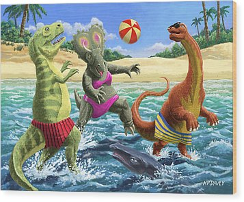 dinosaur fun playing Volleyball on a beach vacation Wood Print by Martin Davey