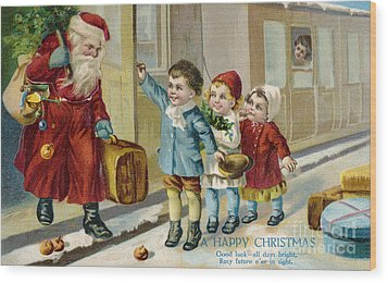 Father Christmas Disembarking Train Wood Print by Mary Evans