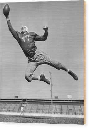 Football Player Catching Pass Wood Print by Underwood Archives