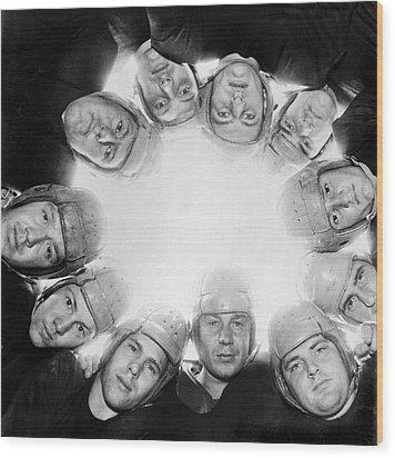 Football Team Huddle Wood Print by Underwood Archives