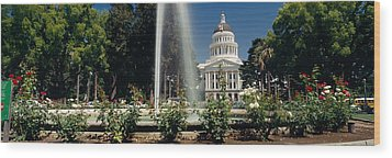 Fountain In A Garden In Front Wood Print by Panoramic Images