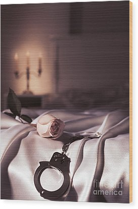 Handcuffs And A Rose On Bed Wood Print by Oleksiy Maksymenko