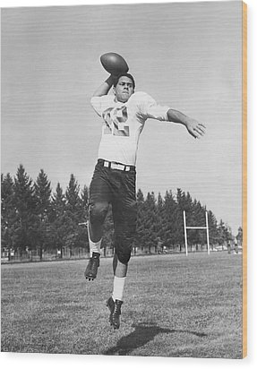 Joe Francis Throwing Football Wood Print by Underwood Archives