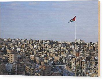 Jordanian Flag Flying Over The City Of Amman Jordan Wood Print by Robert Preston