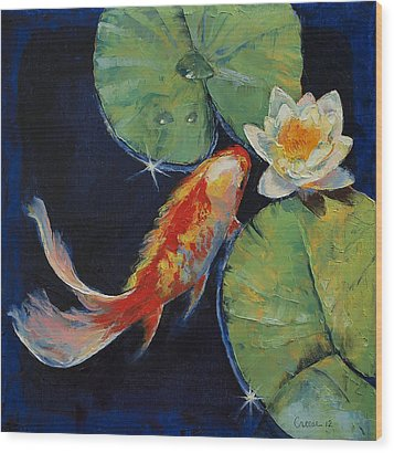Koi And White Lily Wood Print by Michael Creese