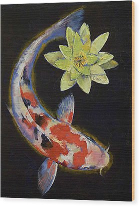 Koi With Yellow Water Lily Wood Print by Michael Creese