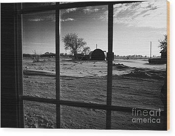 looking out through door window to snow covered scene in small rural village of Forget Saskatchewan  Wood Print by Joe Fox