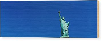 Low Angle View Of Statue Of Liberty Wood Print by Panoramic Images